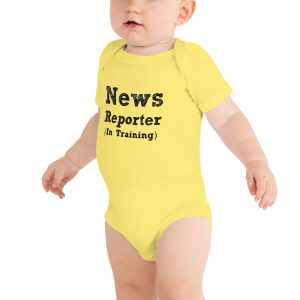 news reporter in training onesie yellow