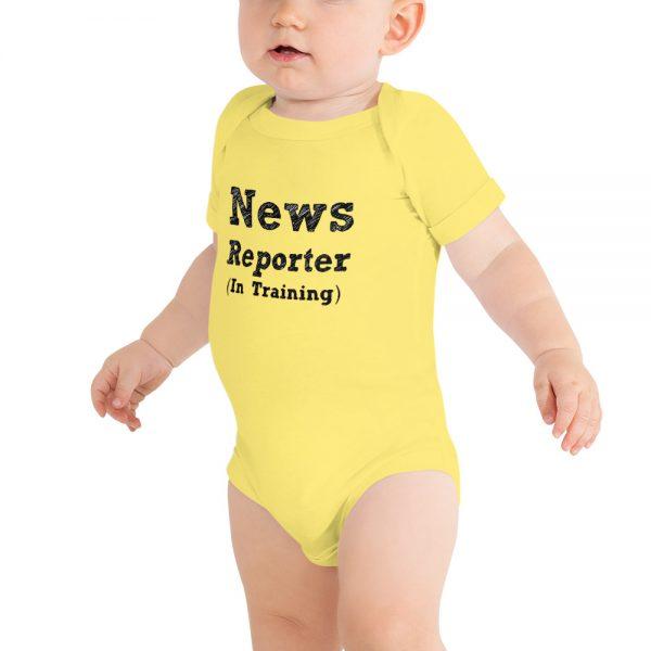 news reporter in training onesie yellow